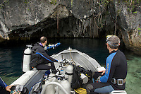 Exploring a cavern/sinkhole connected to the sea..Mark Erdmann (left) and Gerry Allen prepare to dive as they approach the cavern..Sebakor Bay, Fak Fak Peninsula.