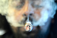 Smokes emanates from a cigar smoker at the Corona Cigar Company & Drew Estate Lounge in Orlando, Fla., Wednesday, April 28, 2017. (Phelan M. Ebenhack via AP)