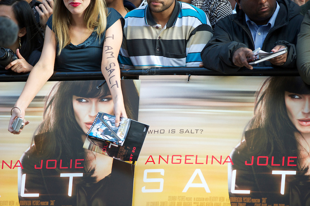 Fans clamor for autographs from Angelina Jolie at the premiere of 'Salt,' on August 16, 2010, at the Empire, Leicester Square in London.
