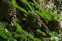 Monju Temple Boddhisatvas - Moss Covered Jizos - Jizo Boddhisatva images and statues are popular in Japan as Bodhisattva who console beings awaiting rebirth and travelers. As such they are often found along roadsides, paths or even street corners.