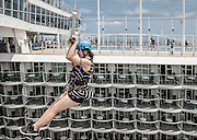 Royal Caribbean, Harmony of the Seas, zip linestake guests on an exhilarating ride across an open-air atrium suspended nine decks high above Boardwalk – a distance of more than 82 feet (25 meters).
