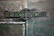 Vintage Electricar electric car badge on open day at Wythall Transport Museum on May 1st 2017 in Wythall, England, United Kingdom. The Transport Museum, Wythall is a transport museum just outside Birmingham, at Wythall, Worcestershire.The museum is run by the charity The Birmingham and Midland Motor Omnibus Trust BaMMOT. The museum has three halls, presenting a significant collection of preserved buses and coaches, including Midland Red and Birmingham City Transport vehicles. It is also home to the Elmdon Model Engineering Society EMES who operate the Wythall miniature railway within the grounds of the transport museum, giving rides to public on miniature steam trains.