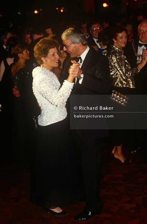 British Prime Minister, John Major and wife Norma dance together at the at the Conservative party conference on 11th October 1991 in Blackpool, England.