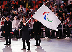 The Mayor of Beijing Chen Jining waves the Paralympic flag during the Closing Ceremony for the PyeongChang 2018 Winter Paralympics in South Korea.