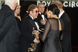 The Duke and Duchess of Sussex speak with Elton John at the European Premiere of Disney's The Lion King at the Odeon Leicester Square, London.
