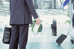 Dec. 05, 2012 - Businessman holding airline ticket (Credit Image: © Image Source/ZUMAPRESS.com)