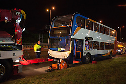 © licensed to London News Pictures. London, UK 01/08/2012. A cyclist was struck by an official Olympic bus and died at the scene, which is at the junction of the Eastway and the A12 East Cross Route, close to the northwestern corner of the Olympic Park at around 7.40pm on 01/08/12. The official Olympic bus, which involved to the incident, being lifted to be investigated at the crime scene.  Photo credit: Tolga Akmen/LNP