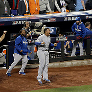 Salvador Perez, (center), Kansas City Royals, cheers as Christian Colon rounds the bases to score a run during the New York Mets Vs Kansas City Royals, Game 5 of the MLB World Series at Citi Field, Queens, New York. USA. 1st November 2015. Photo Tim Clayton