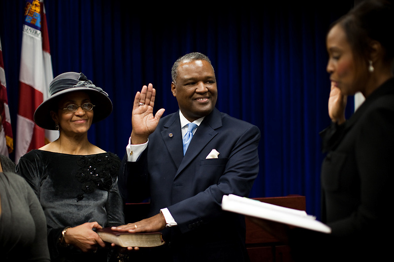 UPPER MARLBORO, MD - DECEMBER 6: Prince George's County Executive-Elect Rushern Baker III takes the oath during the official swearing-in at Prince George's County Administration Building on his inauguration day on December 6, 2010 in Upper Marlboro, Maryland. (Photo by Michael Starghill, Jr.)