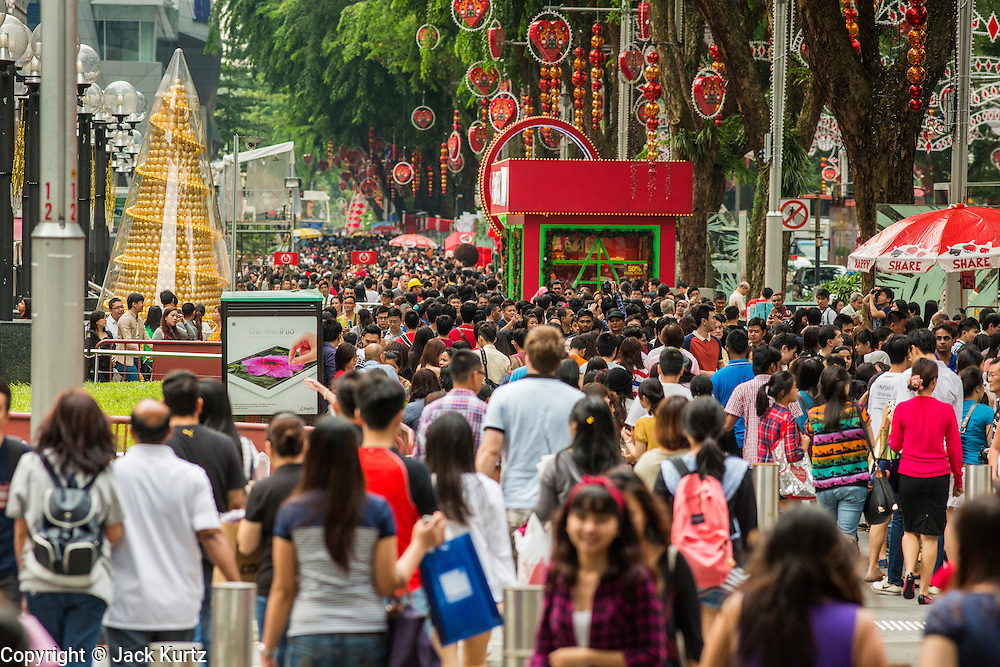 """22 DECEMBER 2012 - SINGAPORE, SINGAPORE:  The crowd on Orchard Road during the Christmas on a Great Street in Singapore. Orchard Road, Singapore's famed shopping street, sponsors the annual event, called """"Christmas on a Great Street."""" The street is decorated with holiday lights, stores stay open late and crowds pack the area. This is the 8th year Singapore has held the """"Christmas on a Great Street"""" event.   PHOTO BY JACK KURTZ"""