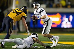 Nevada quarterback Carson Strong (12) rolls out to pass with California linebacker Evan Tattersall (54) in pursuit during the third quarter of an NCAA college football game, Saturday, Sept. 4, 2021, in Berkeley, Calif. (AP Photo/D. Ross Cameron)