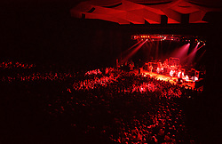 Grateful Dead in Concert at the Saratoga Performing Arts Center, 25 June 1984. Shot during the second set, deep red lights spilling out onto the floor.