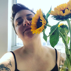 """Lena Dunham releases a photo on Instagram with the following caption: """"Why are there not more pop songs about sunflowers?"""". Photo Credit: Instagram *** No USA Distribution *** For Editorial Use Only *** Not to be Published in Books or Photo Books ***  Please note: Fees charged by the agency are for the agency's services only, and do not, nor are they intended to, convey to the user any ownership of Copyright or License in the material. The agency does not claim any ownership including but not limited to Copyright or License in the attached material. By publishing this material you expressly agree to indemnify and to hold the agency and its directors, shareholders and employees harmless from any loss, claims, damages, demands, expenses (including legal fees), or any causes of action or allegation against the agency arising out of or connected in any way with publication of the material."""