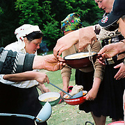 Measurement of the Milk Festival, Botiza, Maramures, Romania. After the sheep have been milked, the shepherds' wives cook up a huge cauldron of soup for the villagers using several whole sheep and if you are lucky you'll get a sheep's skull in your bowl.