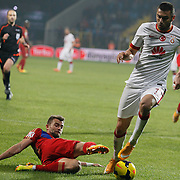 Galatasaray's Burak Yilmaz (R) during their Turkish superleague soccer match Kardemir Karabukspor between Galatasaray Dr. Necmettin Seyhoglu stadium in Karabuk Turkey on Saturday 08 November 2014. Photo by Kurtulus YILMAZ/TURKPIX