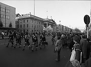 """H-Block Hunger-Strike Protest.   (M54)..1980..06.12.1980..12.06.1980..6th December 1980..In support of the prisioners on hunger strike in Northern Ireland a protest march was organised in Dublin. The march was to highlight the treatment of prisioners who wer on hunger strike and on the """"blanket"""" protest. Part of the prisioner demand was that they be treated as political prisioners and not as criminals or terrorists..Image shows the march led by a pipe band setting out from the G.P.O.in Dublin on their way to the British Embassy."""