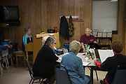 DURANT, OKLAHOMA - MARCH 24:  Vowell Posey leads the group in singing hymns at the Bryan County Retired Senior Volunteer Program in Durant, Oklahoma on March 24, 2017. (Photo by Cooper Neill for The Washington Post)