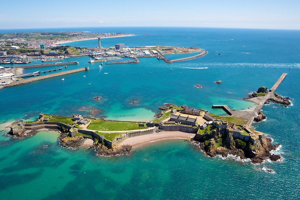 Aerial View of Elizabeth Castle and Jersey harbour and south coast behind it, with its calm and crystal clear water in Jersey, Channel Islands