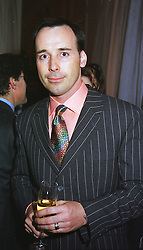 MR DAVID FURNISH close friend of musician Elton John, at a party in London on 26th May 1999.MSN 105