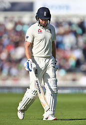 England's Jonny Bairstow looks dejected as he leaves the field after being given out for a duck from bowling by India's Ishant Sharma during the test match at The Kia Oval, London.