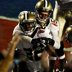 2010 February 07: New Orleans Saints cornerback Tracy Porter (22) celebrates with cornerback Malcolm Jenkins (27) and linebacker Scott Shanle (58) after returning an interception for a touchdown in the fourth quarter during a 31-17 win by the New Orleans Saints over the Indianapolis Colts in Super Bowl XLIV at Sun Life Stadium in Miami, Florida.