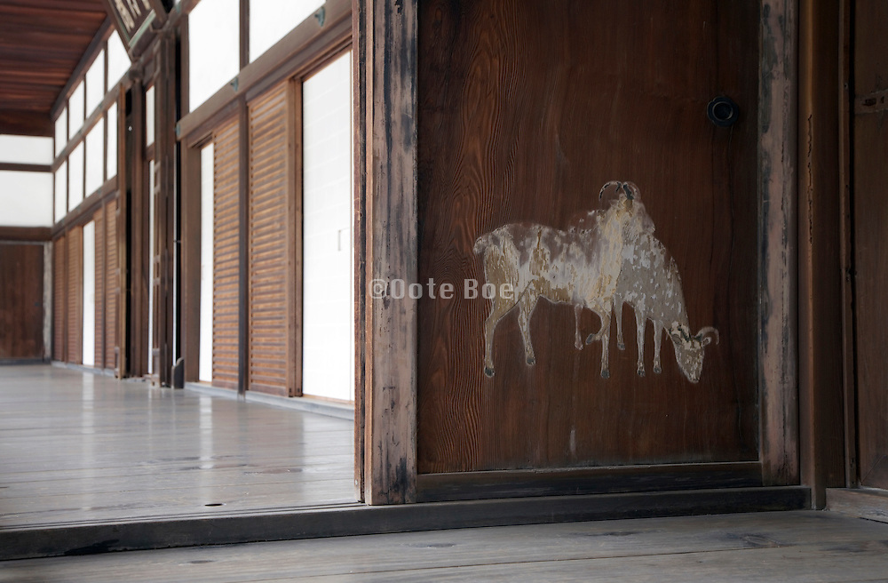 fading painting on wooden door at the Zen temple complex Tofukuji by Kyoto