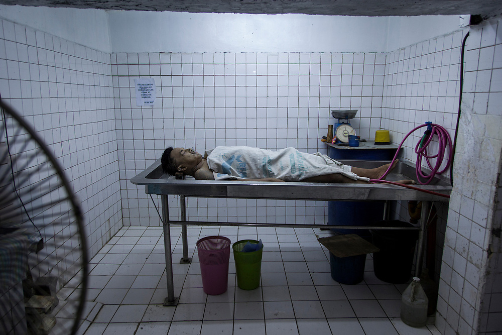 A body of a man recently killed is prep for cleaning at Eusebio morgue in Navotas, Manila.  <br /> <br /> Over 12 thousand people including men, women and even young teens who are mostly the urban poor, have been killed since President Duterte initiated the campaign against drugs. The killings or executions are carried out by masked gunmen. Bodies in morgue showed signs that the victims were bound or handcuffed but the police report often states they fought back or tried to run away.