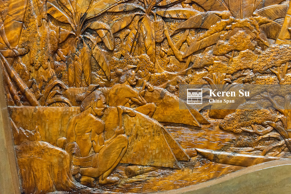 Wood carving depecting local life, Yap Island, Federated States of Micronesia