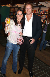 NATHALIE MILTON and GILES ANDREAE author and creator of Purple Ronnie the cartoon character, at a party to celebrate the publicarion of The Meaning of Tingo by Adam Jacot de Boinod held at the Daunt Bookshop, 83 Marylebone High Street, London on 18th October 2005.<br /><br />NON EXCLUSIVE - WORLD RIGHTS