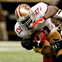 November 25, 2012; New Orleans, LA, USA; San Francisco 49ers running back Frank Gore (21) is tackled by New Orleans Saints middle linebacker Curtis Lofton (50) during the second half of a game at the Mercedes-Benz Superdome. The 49ers defeated the Saints 31-21. Mandatory Credit: Derick E. Hingle-US PRESSWIRE