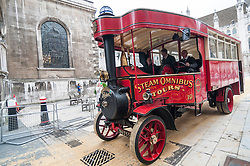 © Licensed to London News Pictures. 15/07/2015. London, UK. A Foden steam-omnibus departs Guildhall during the historic Marking of Carts, which is run by The Worshipful Company.  Horse drawn carts, steam-powered and as modern modes of transport all received a branding as part of the ceremony.  Leading the ceremony were Sheriff Fiona Adler and Chief Commoner, Deputy Billie Dove OBE. Photo credit : Stephen Chung/LNP