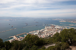 Photographs from the top of the Rock of Gibraltar. Images of Gibraltar, the British overseas territory located on the southern end of the Iberian Peninsula at the entrance of the Mediterranean.