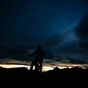 Riding the singletrack of Lake Sophia park outside of Torres del Paine National Park in Chile just after sunset.