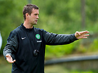 02/07/14<br /> CELTIC TRAINING<br /> AUSTRIA<br /> Celtic Manager Ronny Deila (right) gives out instructions at pre-season training