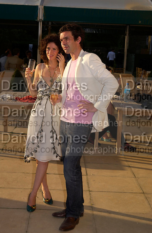 Mollie Dent-Brocklehurst and Elliot Macdonald. Mollie Dent-Brocklehurst and Vanity Fair host  the opening of 'Vertigo'  a mixed art exhibition at Sudeley Castle. Winchombe, Gloucestershire. 18 June 2005. ONE TIME USE ONLY - DO NOT ARCHIVE  © Copyright Photograph by Dafydd Jones 66 Stockwell Park Rd. London SW9 0DA Tel 020 7733 0108 www.dafjones.com
