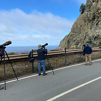 Photographers line an abandoned section of California Highway 1 as it winds through The Devils Slide south of San Francisco.