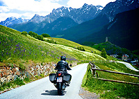 """American motorcyclist John Hermann has earned the title, """"King of the Alps"""".  Decades of exploring the Alps on BMW motorcycles covering 250,000 miles, resulted in his being tapped by Whitehorse Press to write a guidebook of motorcycle touring in this magical place.  The book was so popular, it was published in five editions.  We made this image in the upper Engadine Valley on John's trip in the Spring of 2012."""