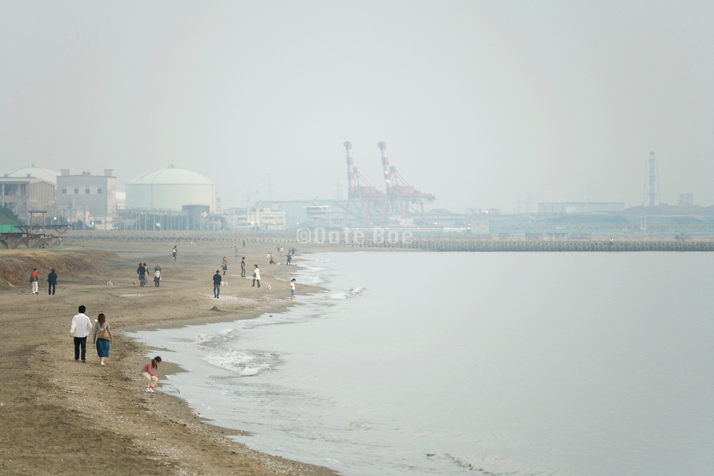 coastal industry near Tokyo with people walking along the water
