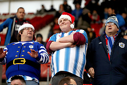 Festively dressed Huddersfield fans in the stands during the Premier League match at St Mary's, Southampton.