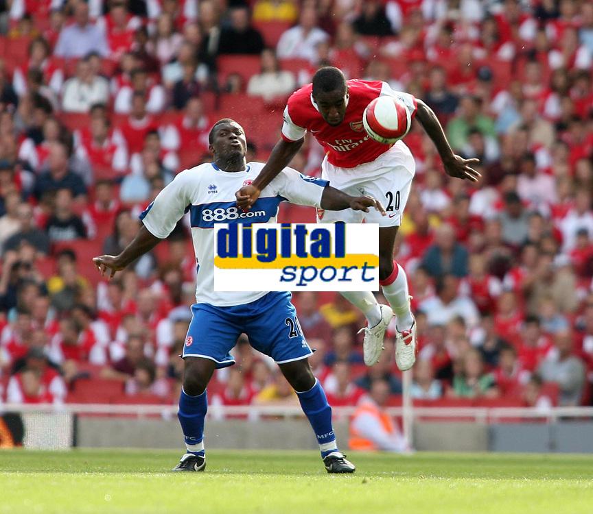Photo: Chris Ratcliffe.<br />Arsenal v Middlesbrough. The Barclays Premiership. 09/09/2006.<br />Aiyegbeni Yakubu of Middlesbrough clashes with Johan Djourou of Arsenal.