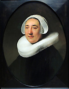Portrait of Haesje Jacobsdr van Cleyburg by Rembrandt Harmensz van Rijn (1606-1669) oil on panel, 1634.  Haesje van Cleyburg, the wife of a wealthy Rotterdam beer brewer, is fashionably yet extremely soberly dressed.  She has not been made more beautiful than she was: the wrinkles, shadows under her eyes, the bushy eyebrows, and the greying hair are all rendered with painstaking realism.  What makes the portrait so charming is the faint smile that plays across her slightly parted lips.