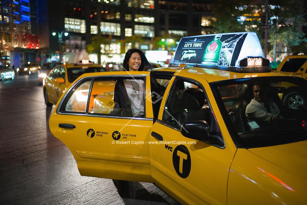 Photographer Nicole Tung in New York at Columbus Circle in Manhattan. <br /> <br /> Photo © Robert Caplin