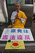 A Buddhist priest at an Anti nuclear protest by women outside the Ministry of Economy, Trade and Industry (METI) in Tokyo Japan. Friday November 4th 2011. The protest ran from October 27th to Noverber 5th. Originally started my mothers from Fukushima protesting about nuclear contamination from October 30th to November 5th the protest welcomed women and people from all over Japan.