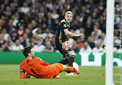 BRITAIN-LONDON-FOOTBALL-UEFA CHAMPIONS LEAGUE-TOTTENHAM HOTSPUR VS AJAX.(190430) -- LONDON, April 30, 2019  Ajax's Donn van de Beek has his shot saved by Tottenham Hotspurs goalkeeper Hugo Lloris during the UEFA Champions League Semifinal First Leg match between Tottenham Hotspur and Ajax at The Tottenham Hotspur Stadium in London, Britain on April 30, 2019. Ajax won 1-0.  FOR EDITORIAL USE ONLY. NOT FOR SALE FOR MARKETING OR ADVERTISING CAMPAIGNS. NO USE WITH UNAUTHORIZED AUDIO, VIDEO, DATA, FIXTURE LISTS, CLUB/LEAGUE LOGOS OR ''LIVE'' SERVICES. ONLINE IN-MATCH USE LIMITED TO 45 IMAGES, NO VIDEO EMULATION. NO USE IN BETTING, GAMES OR SINGLE CLUB/LEAGUE/PLAYER PUBLICATIONS. (Credit Image: © Matthew Impey/Xinhua via ZUMA Wire)