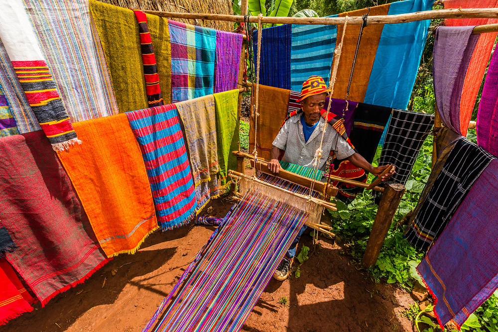 A Dorze  man weaving textiles in his village. The Dorze people are renowned throughout Ethiopia for their weaving tradition and skills. Southern Nations Nationalities and People's Region, Ethiopia.