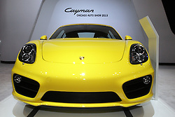 08  February 2013: 2014 Porsche Cayman S high performance sports car. Chicago Auto Show, Chicago Automobile Trade Association (CATA), McCormick Place, Chicago Illinois<br /> <br /> 2014 PORSCHE CAYMAN: Sports car buffs, be on the lookout for the completely redeveloped 2014 Cayman that will be displayed in the Porsche exhibit during the 2013 Chicago Auto Show. This is the third generation of the mid-engined, rear-wheel drive two-seater, with prominent new body lines and proportions; 2.4-inch longer wheelbase, new chassis and up to 60 pounds lighter than previous editions. The '13 Cayman comes standard-equipped with the 2.7 liter flat-six cylinder engine that creates 275 horsepower. For thrill-seekers, the Cayman S provides drivers with a 3.4L six cylinder generating 325hp. Both engines can be mated to either the six-speed manual or seven-speed Porsche Doppelkupplungsgetriebe (PDK) automatic gearboxe. The optional Sport Chrono PDK transmission offers Sport Plus button and dynamic transmission mounts for the most rapid launches from rest. To match the higher performance limits of the '13 Cayman, the ceramic composite brake system with calipers painted yellow remains available. Brand new this year are optional Adaptive Cruise Control (ACC), which controls vehicle distance and speed in traffic, and a specially developed Burmester sound system. Offered for the first time in the Cayman, is Porsche Entry & Drive that enables keyless control of locks and engine starting. Optional bi-color leather packages lend an exclusive, upscale ambiance to the Cayman's interior. Lime gold, pebble gray, or amber leather may be combined with the agate gray leather to striking effect.