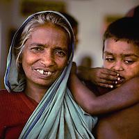 BANGLADESH, Dhaka. Impoverished Bengali mother & son at Mirpur destitute camp, 1977.