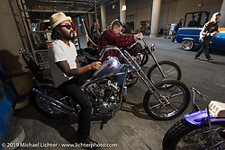 Kosuke Saito of Sunrise Cycles on his 1936 Knucklehead chopper stages for the grand entry into the Annual Mooneyes Yokohama Hot Rod and Custom Show. Japan. Sunday, December 7, 2014. Photograph ©2014 Michael Lichter.