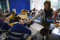 Physically disabled pupils working with a speech and language therapist,