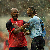 Fotball<br /> England 2004/2005<br /> Foto: SBI/Digitalsport<br /> NORWAY ONLY<br /> <br /> Lucas Radebe Testimonial, Leeds United XI v International XI, 02/05/2005.<br /> <br /> The rain poured down halfway through the game but failed to dampen spirits as Lucas Radebe (R) shares a laugh with Doctor Khumalo